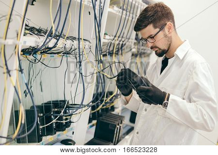 Professional network hardware inspection and male worker