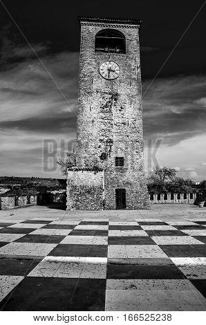 Castelvetro Modena clock tower checkerboard floor black and white