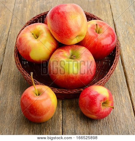 raw red apples on a wooden surface