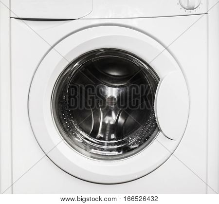 Close-up of a closed door of empty washing machine
