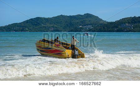 Tourists Enjoying On The Patong Beach