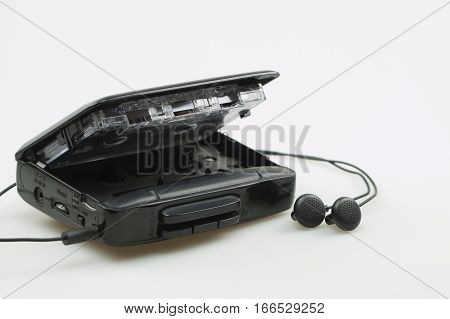 Cassette player with earphones and audio tape