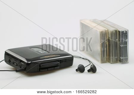 Cassette player with earphones and audio tapes