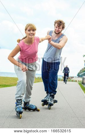 Woman Encourage Man To Do Rollerblading