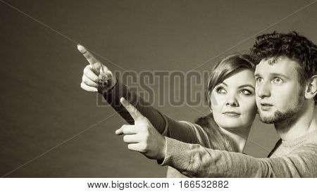 Scared Young Couple Showing Copy Space.