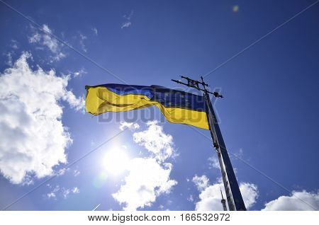Ukrainian flag. EU Flag. Flag on the sky. The flag on the background of the sun. European Union Flag.