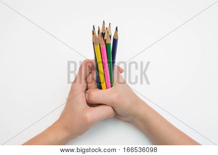 Female Hand Clenched In A Fist Dozen Pencils