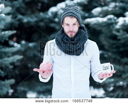 Handsome Man With Moneybox And Cup In Winter Outdoor