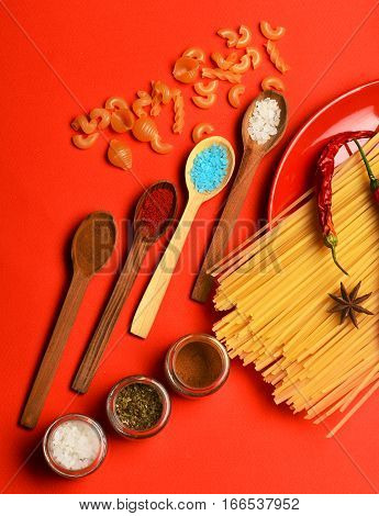 Cooking Pasta With Spice, Chili And Badian On Red Background