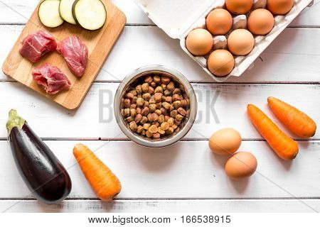 ingredients for pet food holistic top view on wooden background.