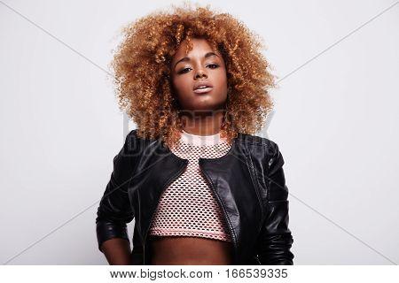Black Woman With Blonde Hair In Studio Shoot