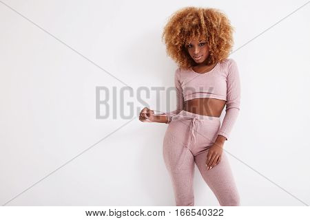 pretty blonde black girl in pink on white