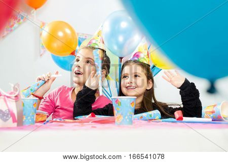 Kids celebrating birthday party on the white