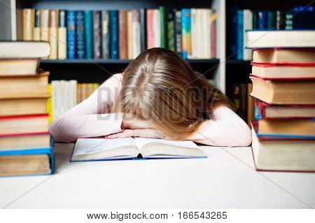 Tired Student Girl With Books Sleeping On The Table. Education, Session, Exams And School Concept .