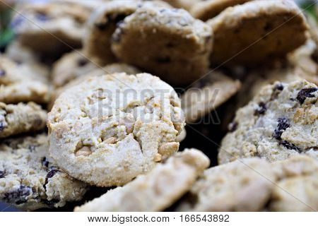 Pile of shortbread cookies with peanut butter chips and blueberries, close up