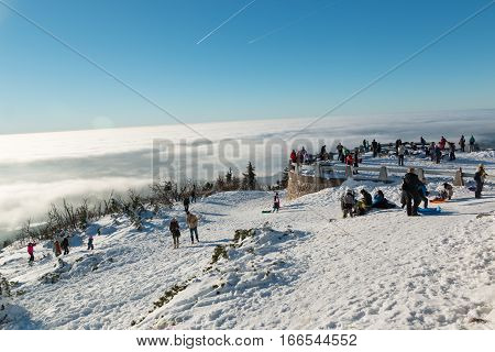 JESTED, CZECH REPUBLIC - 21.01.2017: People on terrace in mountain Jested over clouds Czech Republic