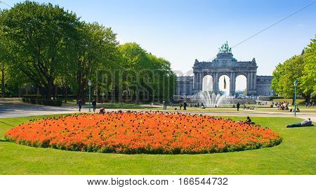BRUSSELS BELGIUM - April 13, 2014: Triumphal Arch in Cinquantenaire Parc in Brussels Belgium with flowers