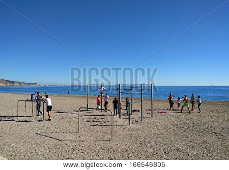 Aguadulce Spain-December 26 2016: Active people on the beach of Aguadulce. Aguadulce is a spanish locality of Roquetas de Mar province of Almeria. Spain