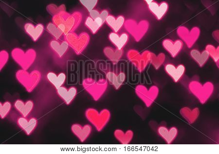 St Valentines Day pink heart bokeh background with shining St Valentines day hearts. St Valentines day postcard
