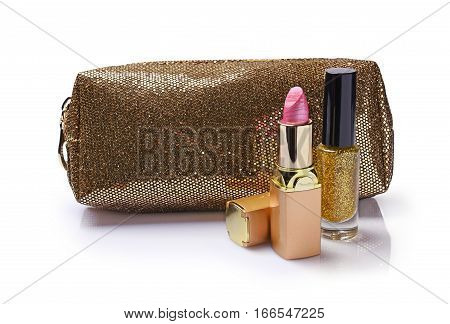 Composition Of Cosmetics With Golden Cosmetic Bag