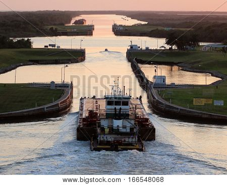 Tug boat and barge entering lock along the Intra-coastal waterway