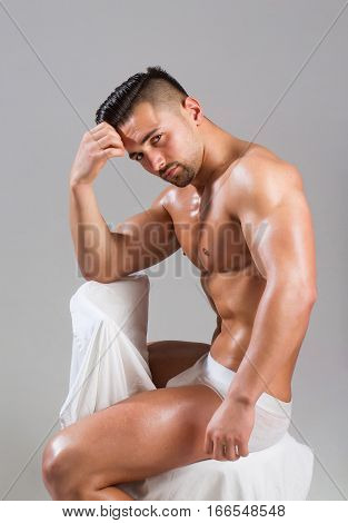 Handsome Bodybuilder Sits On Chair