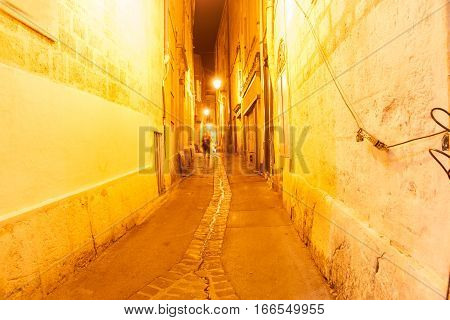 Golden glow in back streets and lanes at night Montpellier France urban & architectural
