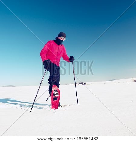 Man Cleaning Snowshoe. Winter Tourist With Snowshoes Walk In Snow