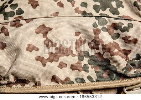 Military texture camouflage background close-up shot macro.