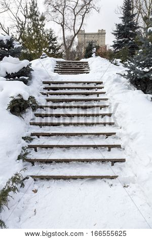 Wooden Stairs Covered With Snow