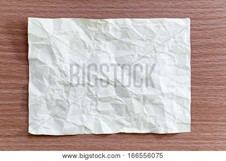 Yellow notepad paper crumpled of empty and copy space on wooden backgroundYou can input the message text in picture.
