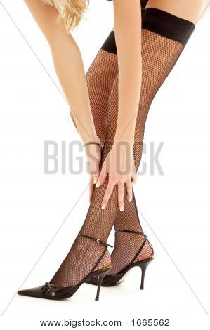 Black Stockings And High Heels Shoes