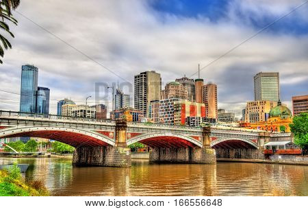 Skyline of Melbourne along the Yarra River and Princes Bridge in Australia