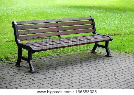 bench to relax on the lawn in the Park
