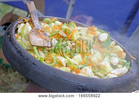 Bulgarian traditional vegetarian food in sach  - close up