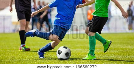 Youth Football Teams Playing Match on Sports Field. Young Boys Running and Kicking Soccer Ball. Football Soccer Duel. Youth Soccer Drill Dribbling
