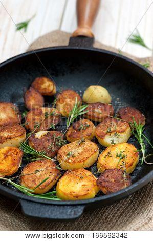 Roasted potato with sea salt and thyme seasoning.