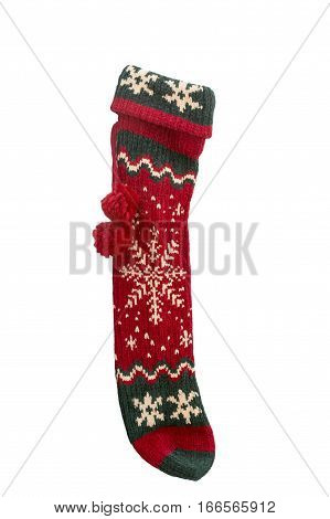 Long red and green knitted Christmas stocking with snowflake design and pompoms isolated on white