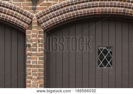 Garage Door Texture with Red Brick Arches and Diamond Paned Window