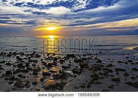 Sunrise morning and stone on Thung Wua Lan Beach at Chumphon Province Thailand.