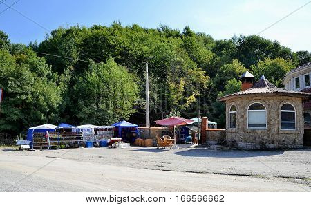A small roadside vegetable market and café.