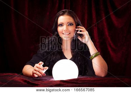 friendly fortune teller with crystal ball giving you advice over the phone