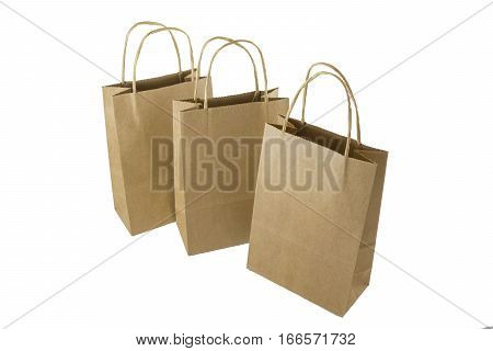 Three plain paper shopping bags on white background