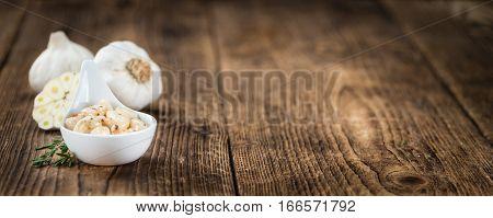 Preserved Garlic (selective Focus) On Vintage Wooden Background