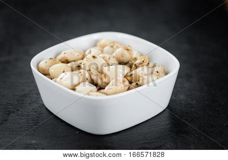 Portion Of Garlic (preserved) On A Slate Slab