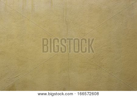 surface of old yellow cement wall for the design background.