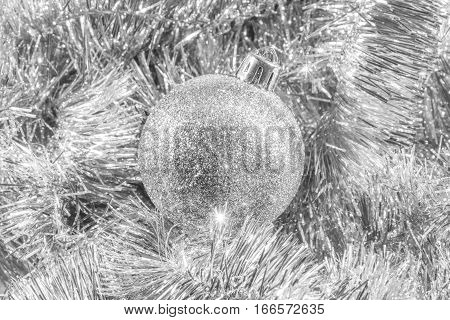Silver glittery Christmas ornament in silver tinsel
