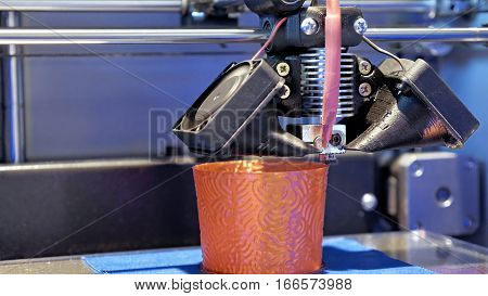 Automatic three dimensional 3d printer performs product creation. Modern 3D printing or additive manufacturing and robotic automation technology.