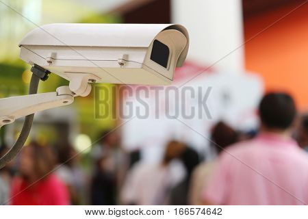 CCTV Camera Record on blur background of people in the Shopping mallconcept of security and safety.