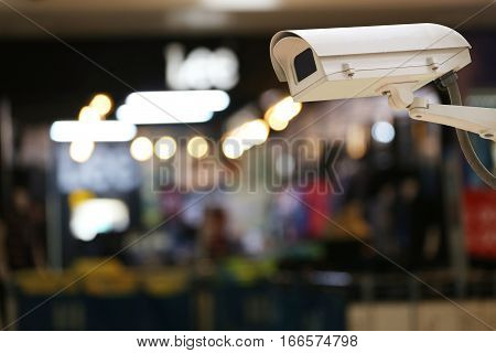 CCTV Camera Record on blur background of interior restaurantconcept of security and safety.